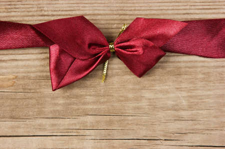 red bow and ribbon on the old wooden background Stock Photo - 16062580
