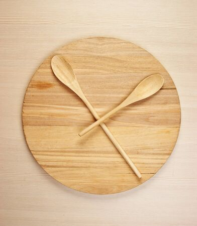 stylized clock - cutting board and wooden spoons photo