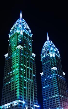 chrysler: DUBAI, UAE-NOVEMBER 14: Night view of the Chrysler building in Dubai on November 14, 2012. Two imitations of NYC Chrysler building.