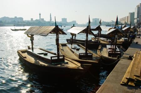 bur dubai: Traditional Abra ferries at the creek in Dubai, United Arab Emirates Stock Photo