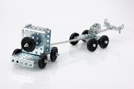 truck tractor toy - metal kit for construction on white background photo
