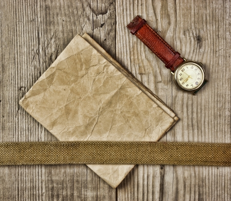 vintage paper and old broken watch on wooden boards photo