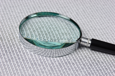 magnifying glass and binary code photo