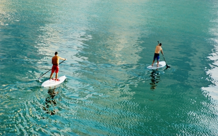 Two surfer in calm water Stock Photo