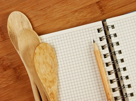notebook for culinary recipes on a kitchen cutting board photo