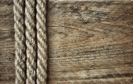 bonding rope: old rope on a wooden background
