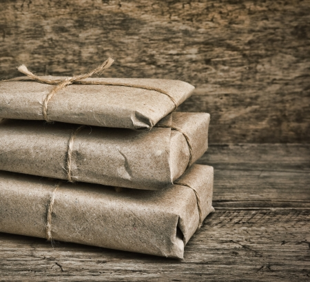pile parcel wrapped with brown kraft paper and tied with twine Stock Photo - 17192281