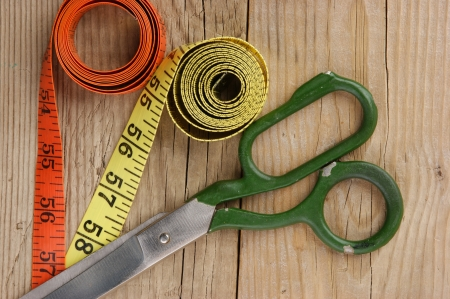 sartorial meter and scissors on the old wooden background Stock Photo - 17192295
