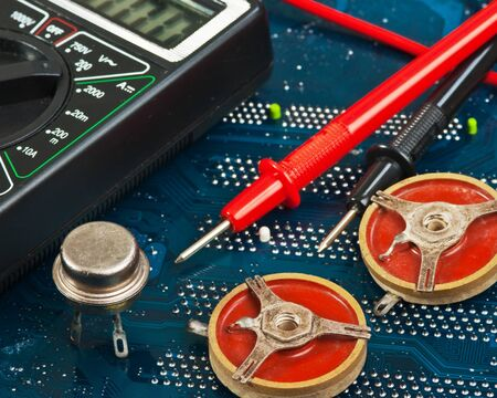 old electronic components on printed circuit board photo