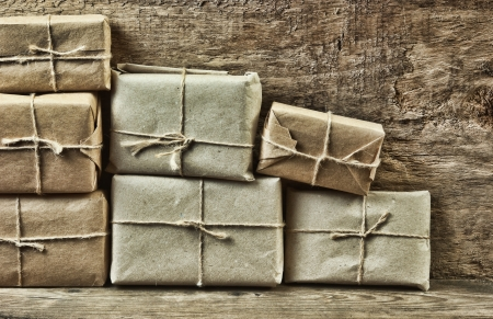 pile parcel wrapped with brown kraft paper and tied with twine Stock Photo - 17406006