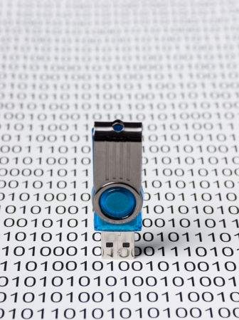 computer virus: USB flash drive on the background of a binary code Stock Photo