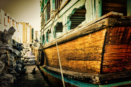 oldest:  Loading a ship in Port Said  The oldest commercial port of Dubai Stock Photo
