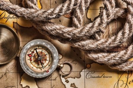 cartographer: compass and rope on a map Stock Photo
