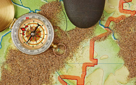 compass on the map with sand Stock Photo - 18130088
