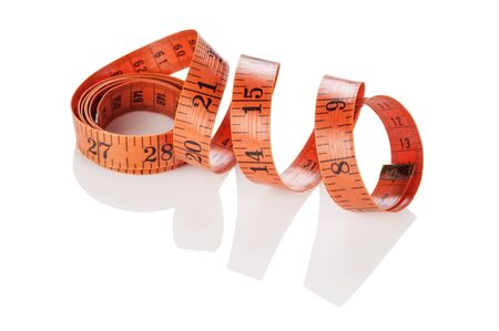 sartorial: Measuring tape of the tailor isolated on white background Stock Photo