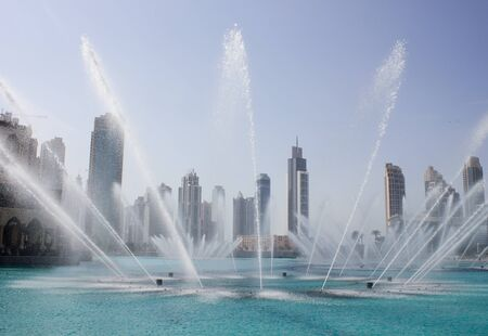 DUBAI, UAE - NOVEMBER 14: The Dancing fountains downtown and in a man-made lake in Dubai, UAE on November 14, 2012. The Dubai Dancing fountains are worlds largest fountains with height 150 m.