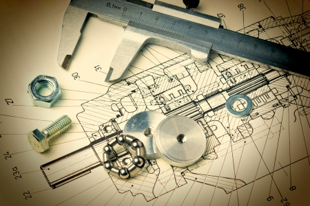 drafting tools: mechanical scheme and calipers with bearing Stock Photo
