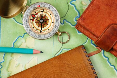 compass wallet and passport on the old map Stock Photo - 18455801