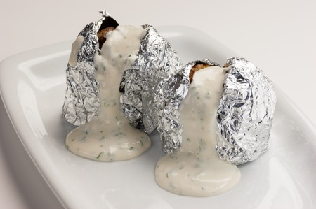 Stuffed potatoes in foil with spices photo