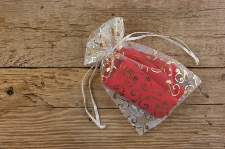 Christmas gift box on the old wooden background photo