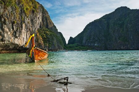 Traditional longtail boats in the famous Maya bay of Phi-phi Leh island, Thailand photo