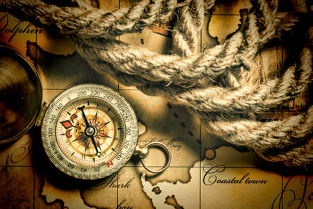 compass and rope on a map Stock Photo - 18676072