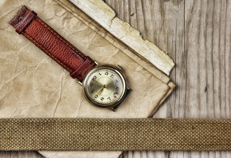 vintage paper and old broken watch on wooden boards Stock Photo - 18812562