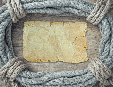 bonding rope: frame made of twisted rope and blank old paper form for records Stock Photo