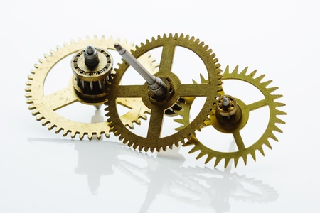 escapement: clockwork gears on white background  Stock Photo