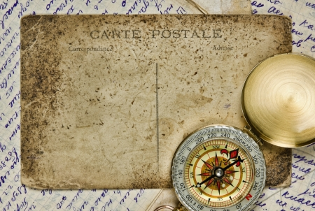 Vintage background with old postcard and letters photo