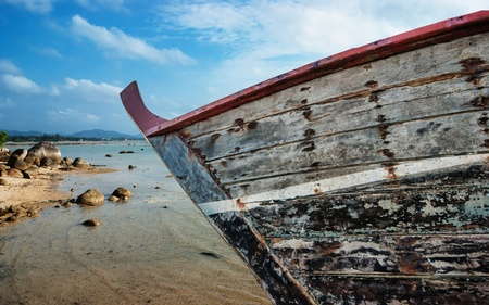 old fishing boat on the beach of the Indian Ocean phuket thailand photo
