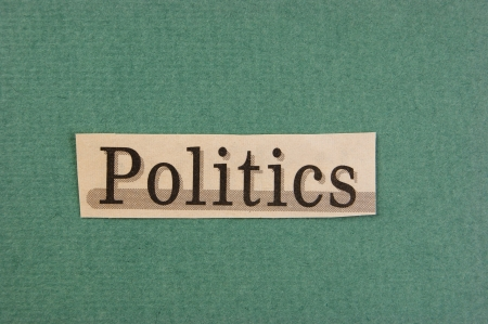 word politics cut from newspaper on green background photo