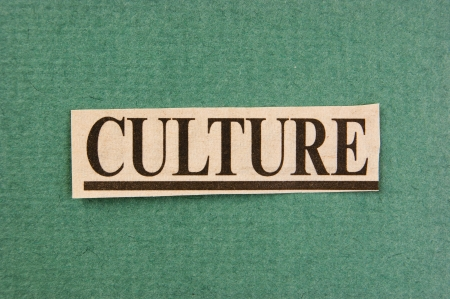 word culture cut from newspaper on green background photo