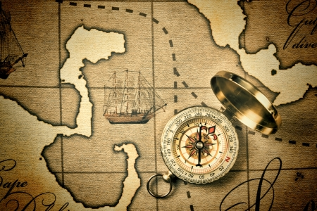 cartographer: Old compass on a stylized map Stock Photo