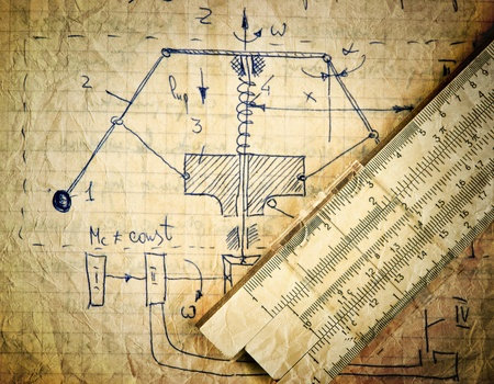engineering design: Page of old paper with the calculation of the theoretical mechanics and slide rule Stock Photo