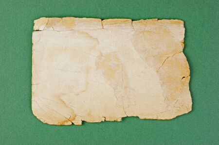 Vintage old paper on the green background Stock Photo - 19289732