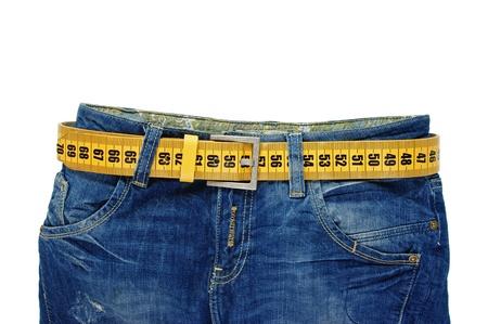jeans met meter riem vermageringsdieet geïsoleerd op de witte achtergrond Stockfoto