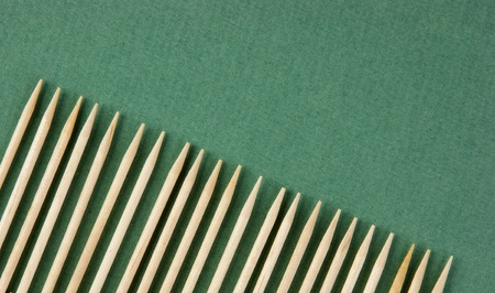 paling: wooden toothpicks in paling shape on the green background Stock Photo
