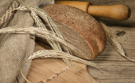 rye bread, and corn on the wooden table photo