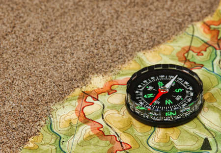 compass on the map with sand photo
