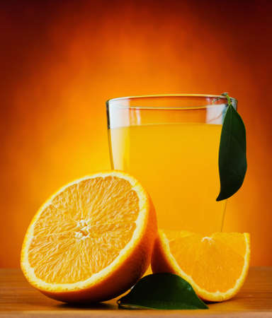 orange and juice on a table photo