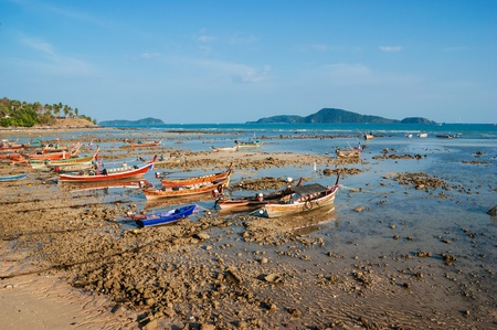 national fishing boats on the shore of the Indian Ocean phuket thailand photo