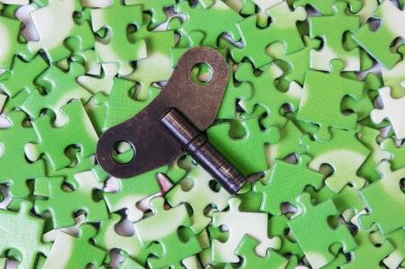 ecomomical: key on pile of green puzzle Stock Photo
