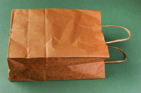 paper bag on a green background photo