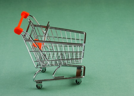 Shopping cart on the green background Stock Photo - 19491022