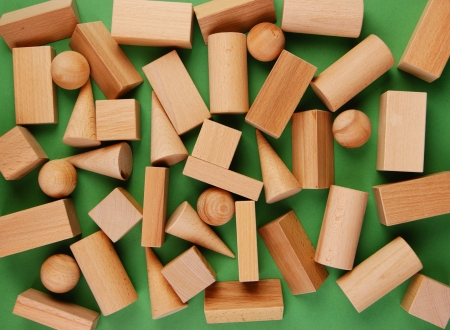 wooden geometric shapes on a green background photo