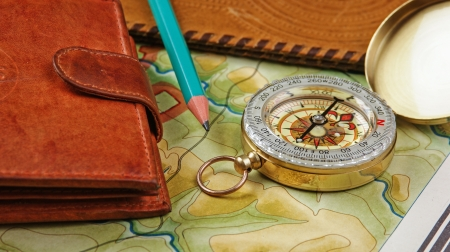compass wallet and passport on the old map photo