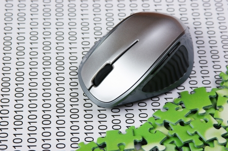 computer mouse and  puzzles on a binary code photo