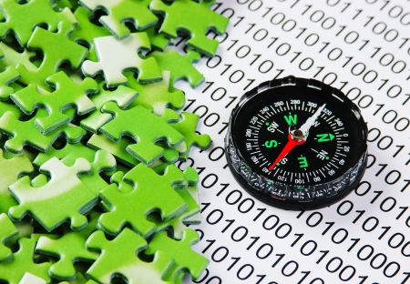puzzles and compass on a binary code Stock Photo