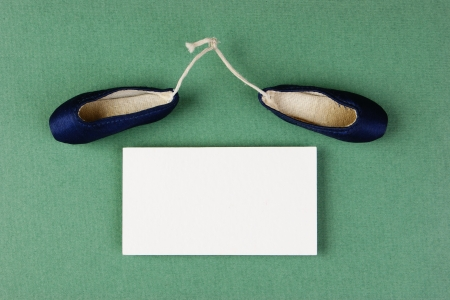 ballet slippers pointe gift and blank business card on the green background photo